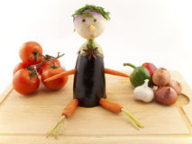 Veg Boy with selection of Veg. Vegetables used to make a veg boy display with healthy veg surrounding him Royalty Free Stock Images