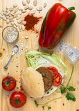 Veg burger. Homemade veg burger with ingredients, on a light wooden background. Top view Royalty Free Stock Photos