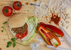 Veg burger. Homemade veg burger with ingredients, on a light wooden background. Top view Royalty Free Stock Photo