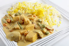 Veg korma and tofu. Vegetable korma curry with tofu, on a plate Stock Photos