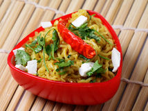 Veg Noodles. Chilly veg noodles in red bowl Royalty Free Stock Photo