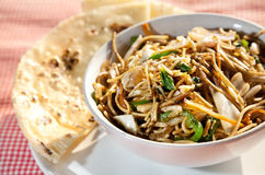 Veg noodles and butter naan Stock Photography