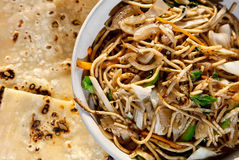 Veg noodles and butter naan Royalty Free Stock Photos