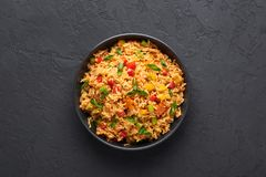 Free Veg Schezwan Fried Rice In Black Bowl At Dark Slate Background. Indo-chinese Cuisine Dish Stock Photography - 159831812