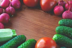 Vegabates  food  view top, wooden frame with vegetables at the edges flat lay royalty free stock photos