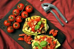Vegan, alkaline , healthy food with grilled zucchini and tomato Stock Image