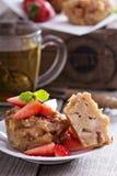 Vegan apple muffins with green tea. Vegan apple muffins with strawberries and green tea Stock Images