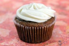 Vegan Applesauce Cupcake. Closeup of vegan applesauce cupcake topped with vegan cream cheese frosting Stock Images