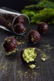 Vegan avocado truffles on dark wooden background. Raw energy bites with coconut and tea matcha. Homemade chocolate candy. Healthy. Plant-based food. Copy space stock images