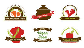 Vegan badges. Set of 6 badges and labels for web and printed materials. They read Homemade vegan cuisine, 100% vegan, Vegan Restaurant, Vegan Food - Eat clean Stock Images