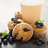 Vegan banana blueberry muffins with coffee to go Stock Photos