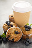 Vegan banana blueberry muffins with coffee to go Royalty Free Stock Images