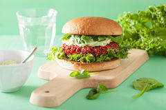 Vegan beet and quinoa burger with avocado dressing Stock Photo