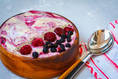 Vegan berry ice-cream shake in wooden bowl. Royalty Free Stock Image