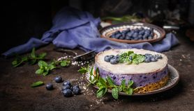 Free Vegan Blueberry Cake On Dark Rustic Kitchen Table Background With Fresh Berries, Side View. Healthy Food Stock Photos - 155721913