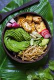 Vegan bowl with avocado, bean sprouts and tofu. Vegan bowl with avocado, silky tofu, bean sprouts and pickled vegetables over rice stock photos