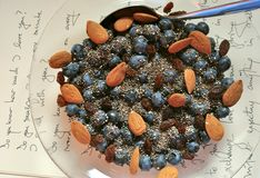 Vegan breakfast with berries and almond seeds Stock Images
