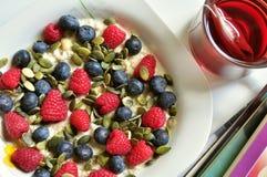 Vegan breakfast with berries and tea Stock Photos