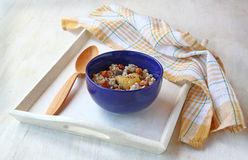 Vegan breakfast of oatmeal with honey and walnuts Stock Photography