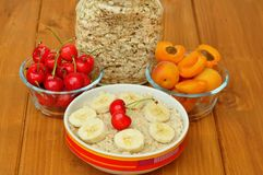 Vegan breakfast with oatmeal porridge and cherries Royalty Free Stock Photos