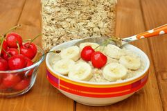 Vegan breakfast with oatmeal porridge and cherries Royalty Free Stock Photography