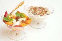 Vegan breakfast with oatmeal porridge and fresh fruit Royalty Free Stock Images