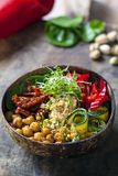 Vegan Buddha bowl with vegetables and chickpeas. Vegan Buddha bowl with chickpeas, courgette, sundried tomatoes and sprouts royalty free stock photos