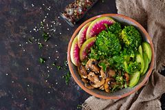 Vegan buddha bowl dinner food table. Healthy food. Healthy vegan lunch bowl. Grilled mushrooms, broccoli, radish salad. Flat lay. Top view Stock Photos
