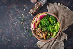 Vegan buddha bowl dinner food table. Healthy food. Healthy vegan lunch bowl. Grilled mushrooms, broccoli, radish salad. Flat lay. Top view Royalty Free Stock Images
