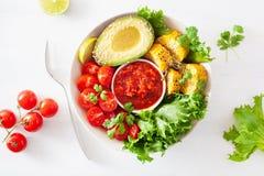 Vegan buddha bowl. healthy lunch bowl with avocado, tomato, sweet corn and salsa stock photo
