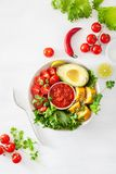 Vegan buddha bowl. healthy lunch bowl with avocado, tomato, sweet corn and salsa royalty free stock photography