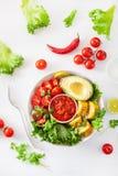 Vegan buddha bowl. healthy lunch bowl with avocado, tomato, sweet corn and salsa royalty free stock photos