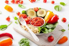 Vegan buddha bowl. healthy lunch bowl with avocado, tomato, bell Royalty Free Stock Photography