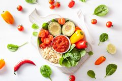 Vegan buddha bowl. healthy lunch bowl with avocado, tomato, bell Royalty Free Stock Image