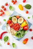 Vegan buddha bowl. healthy lunch bowl with avocado, tomato, bell Stock Image