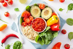 Vegan buddha bowl. healthy lunch bowl with avocado, tomato, bell Stock Photography