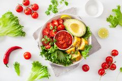 Vegan buddha bowl. healthy lunch bowl with avocado, tomato, sweet corn and salsa royalty free stock images