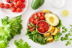 Vegan buddha bowl. healthy lunch bowl with avocado, tomato, sweet corn and salsa stock images