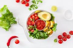 Vegan buddha bowl. healthy lunch bowl with avocado, tomato, sweet corn and salsa stock photos