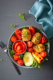 Vegan buddha bowl. healthy lunch bowl with hasselback potato, av stock photography