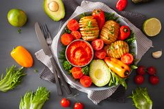 Vegan buddha bowl. healthy lunch bowl with hasselback potato, av royalty free stock photo