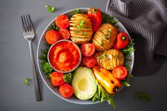 Vegan buddha bowl. healthy lunch bowl with hasselback potato, av royalty free stock images