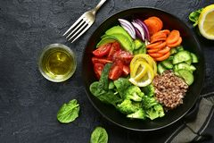 Vegan buddha bowl with vegetables and cereals. Healthy and balanced food concept. royalty free stock photos