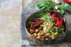 Vegan Buddha bowl with vegetables and chickpeas. Vegan Buddha bowl with chickpeas, courgette, sundried tomatoes and sprouts royalty free stock photo