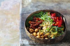 Vegan Buddha bowl with vegetables and chickpeas. Vegan Buddha bowl with chickpeas, courgette, sundried tomatoes and sprouts stock images