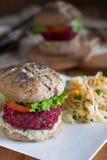 Vegan burger. Vegan  burger with black bean and beetroot patty and buckwheat buns Stock Photo