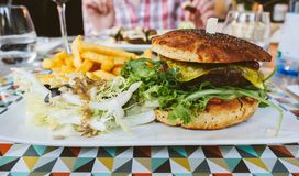 Vegan burger in restaurant stock photography