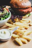 Vegan burger with salad, and french fries royalty free stock photos