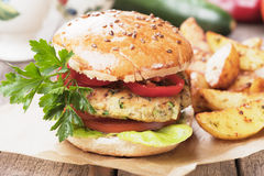 Vegan burger. With tomato and lettuce, healthy vegetarian version of classic american fast food Royalty Free Stock Image