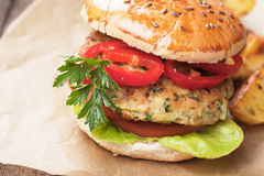 Vegan burger. With tomato and lettuce, healthy vegetarian version of classic american fast food Stock Photography